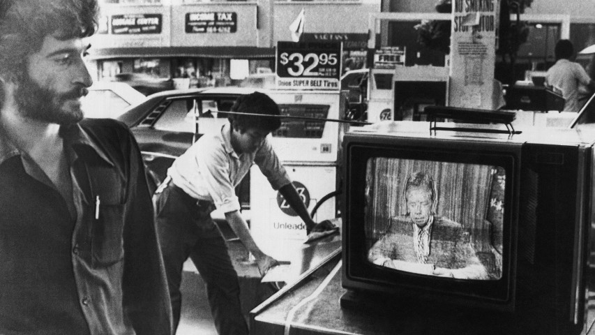 Rami, a gas station manager, watches President Jimmy Carter giving his energy speech over national television, July 15, 1979, in Los Angeles. (AP Photo/Mao)