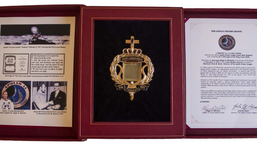 The microform copy of the Apollo 14 lunar-landed King James Bible and other related items available for auction. Image courtesy Nate D. Sanders Auctions