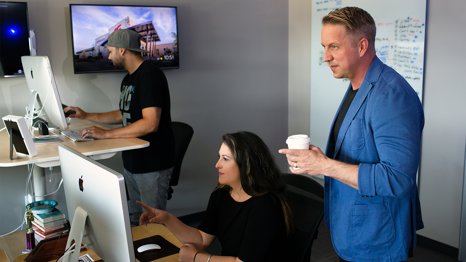 Bobby Gruenewald, right, innovation leader for Life Church, founder of the YouVersion Bible app, works with his team in Edmond, Okla., on June 26, 2018. Celebrating its 10th anniversary, the app has been downloaded on 330 million devices and in every country in the world, according to the church. Photo courtesy of Life Church