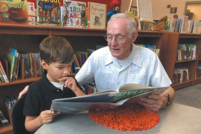 Neal Buchanan (right), a member of Lincoya Hills Baptist Church in Nashville's Donelson community, works with Jonah, 8, a second-grade student at Pennington Elementary. Buchanan has been serving as a volunteer tutor at the school near his house for almost 20 years.