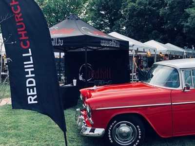 Showcased just outside Red Hill Church's two tents at the Route 66 festival is a 1955 Chevy Bel Air. The gleaming red and white car attracted visitors to the church's display. Submitted photo