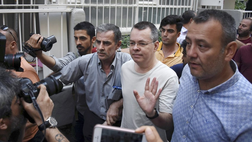 Pastor Andrew Brunson, center, waves as he leaves a prison outside Izmir, Turkey, on July 25, 2018. Brunson, who has been jailed in Turkey for more than 1 ½ years on terror and espionage charges, was released Wednesday and will be put under house arrest as his trial continues. (DHA via AP)