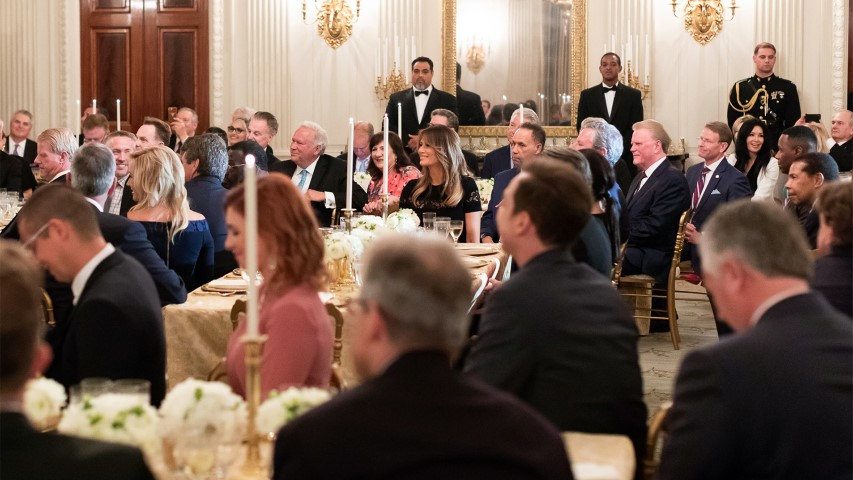 First lady Melania Trump listens to President Trump give remarks during a dinner in celebration of evangelical leadership in the State Dining Room of the White House on Aug. 27, 2018. (Official White House Photo by Andrea Hanks)