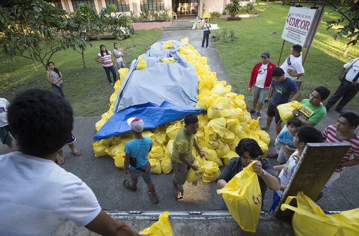 Volunteers load a truck at the offices of the United Methodist Committee on Relief in Manila with relief supplies for survivors of Typhoon Haiyan in the Philippines in November 2013. Photo by Mike DuBose/UMNS