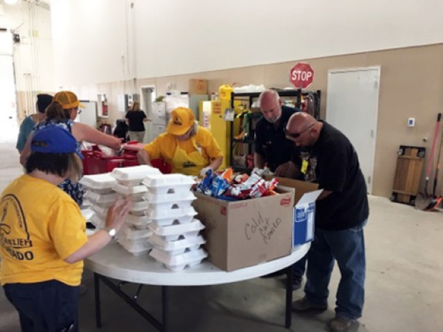Southern Baptist Disaster Relief volunteers prepare meals for those affected by wildfires in southern Colorado in July 2018. Residents and first responders were served. Photo by Dennis Belz via Baptist Press