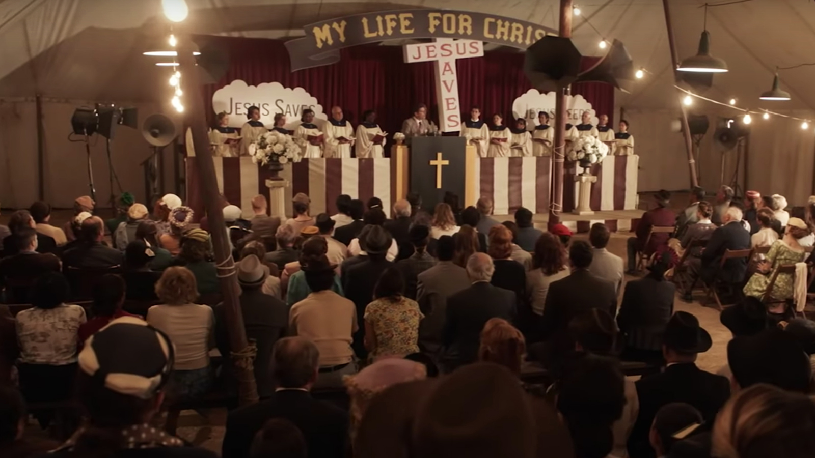 """Billy Graham is played by his grandson Will Graham in a revival scene from """"Unbroken: Path to Redemption."""" Photo courtesy of WTA Group/Universal 1440 Entertainment"""