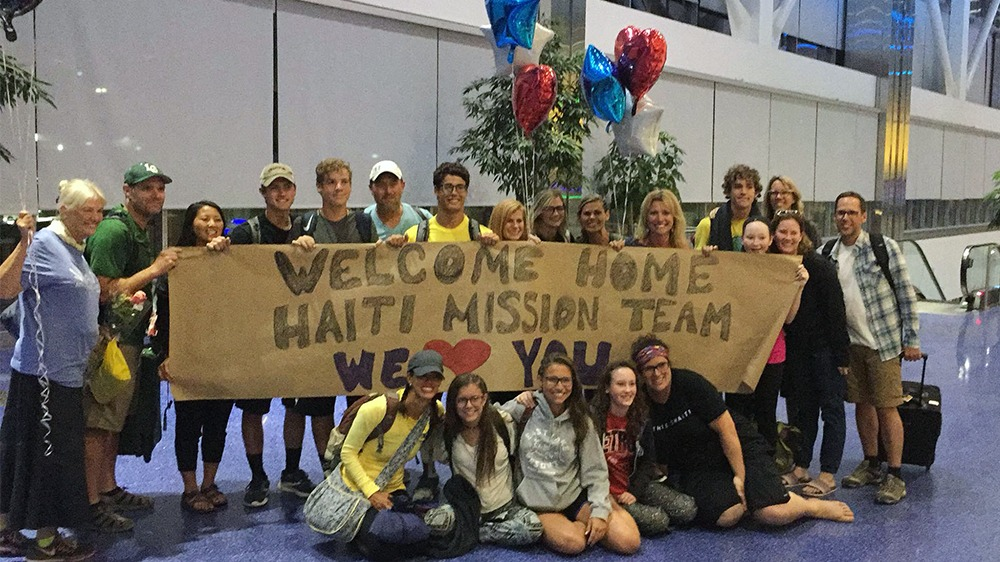 Missionaries from Kensington Church in Troy, Mich., are welcomed upon their return home from a Haiti mission trip in 2018. Photo courtesy Kensington Church