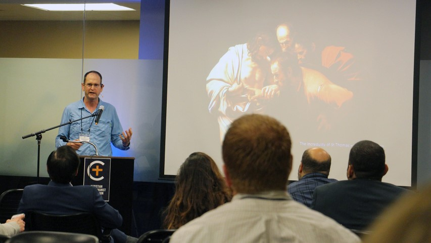 "Jonathan Gunnell presents on ""Simulation Theory and the Implications for Christianity"" at the Christian Transhumanist Conference in Nashville on Aug. 25, 2018. RNS photo by Emily McFarlan Miller"