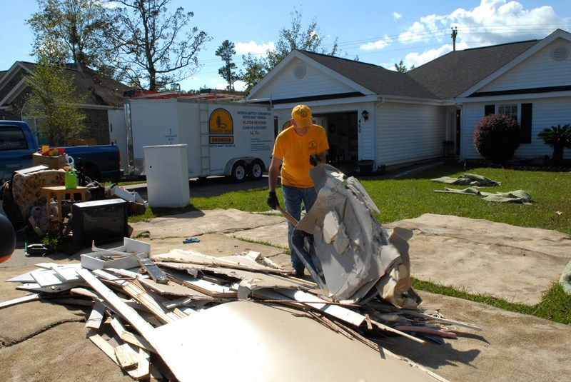 Georgia disaster relief volunteer Fort Oglesby hauls debris to the street from a flood-damaged home in Longs, S.C. He worked with six others to help homeowner Ray Childers, 71, who has lived in his home for 20 years. Childers' wife is in a nursing home and he is staying with his daughter. Almost all of the homes in the community took on several feet of water. Photo by Laura Sikes