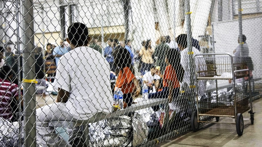 In this June 17, 2018, photo provided by U.S. Customs and Border Protection, people who were taken into custody related to cases of illegal entry into the United States sit in one of the cages at a facility in McAllen, Texas. (U.S. Customs and Border Protection's Rio Grande Valley Sector via AP)