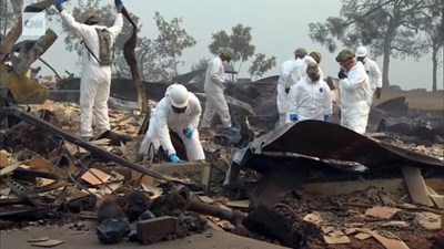 Soldiers sift through what's left of a burned-down home in Paradise, Calif., looking for human remains. Screen capture from CNN
