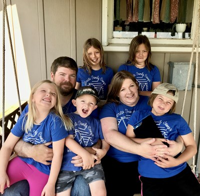 Bethany Wood, with her husband and five children, credits Christian Challenge at her Kansas university for helping her return to the faith that guided her parents when she was growing up. Submitted photo
