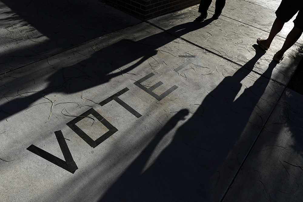 Voters head to the polls at the Enterprise Library on Nov. 6, 2018, in Las Vegas. (AP Photo/Joe Buglewicz)