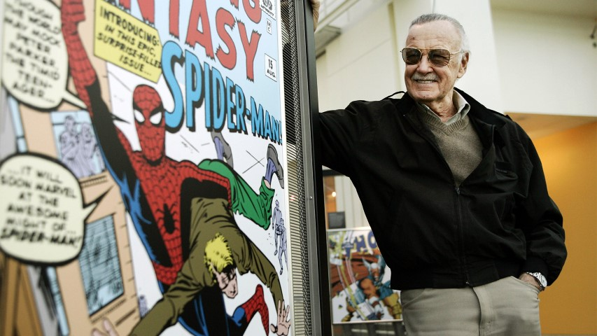 Comic-book creator Stan Lee stands beside some of his drawings in the Marvel Super Heroes Science Exhibition at the California Science Center in Los Angeles on March 21, 2006. (AP Photo/Damian Dovarganes)