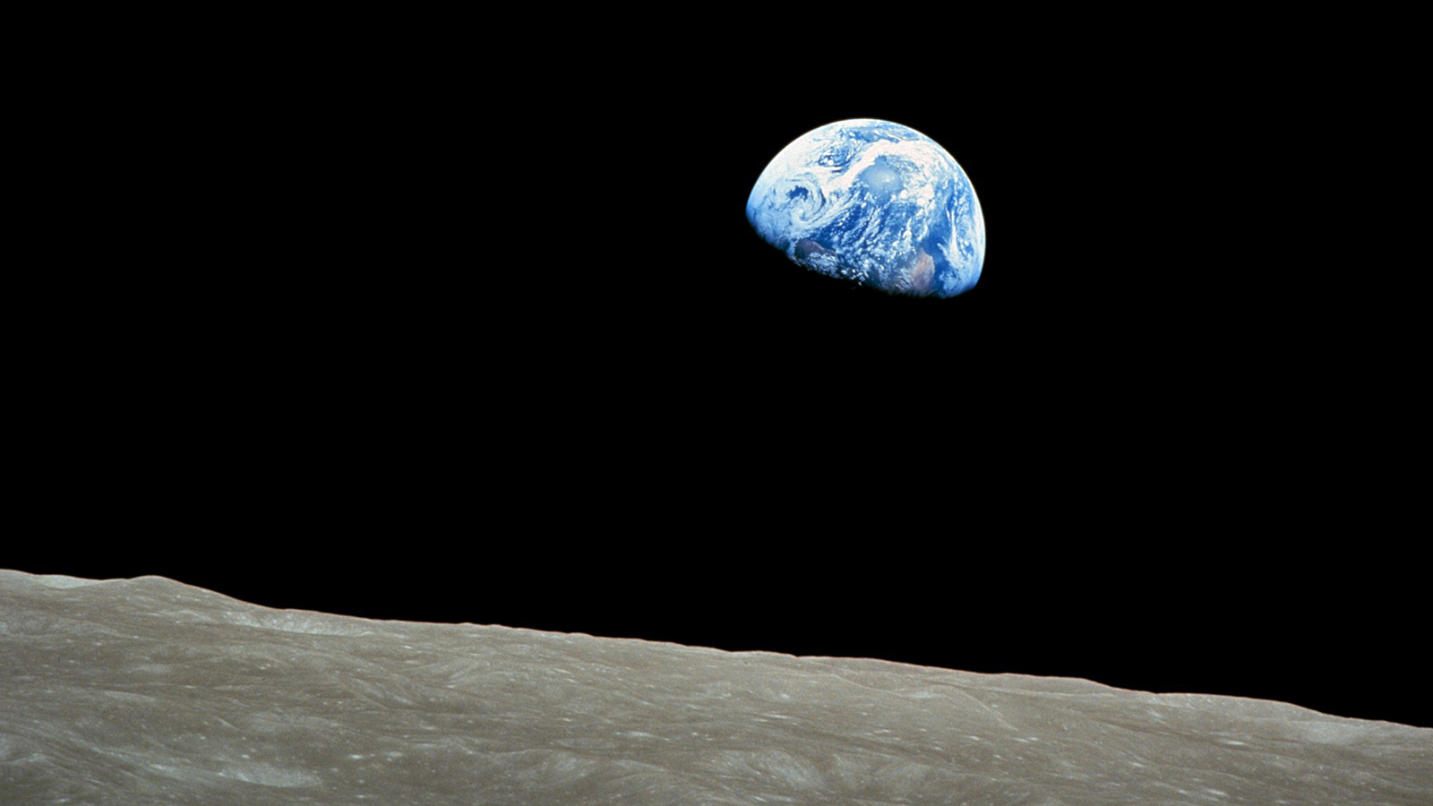 """""""Earthrise"""" is a photograph of the Earth and parts of the moon's surface taken from lunar orbit by astronaut Bill Anders in 1968, during the Apollo 8 mission. Photo by Bill Anders/NASA/Creative Commons"""