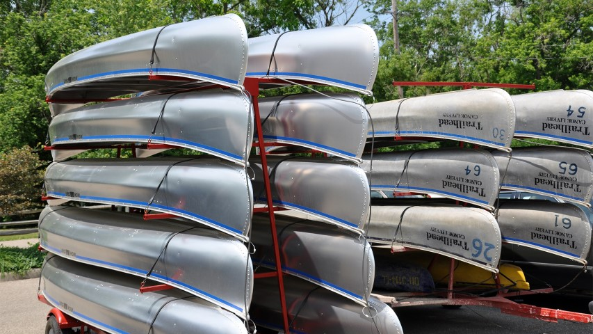 Canoes await campers. Canada has made changes to the federal government's summer jobs program. Photo courtesy of Creative Commons