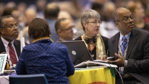 Delegates listen