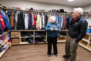 Linda Allen and  Scott Slaba in clothes closet