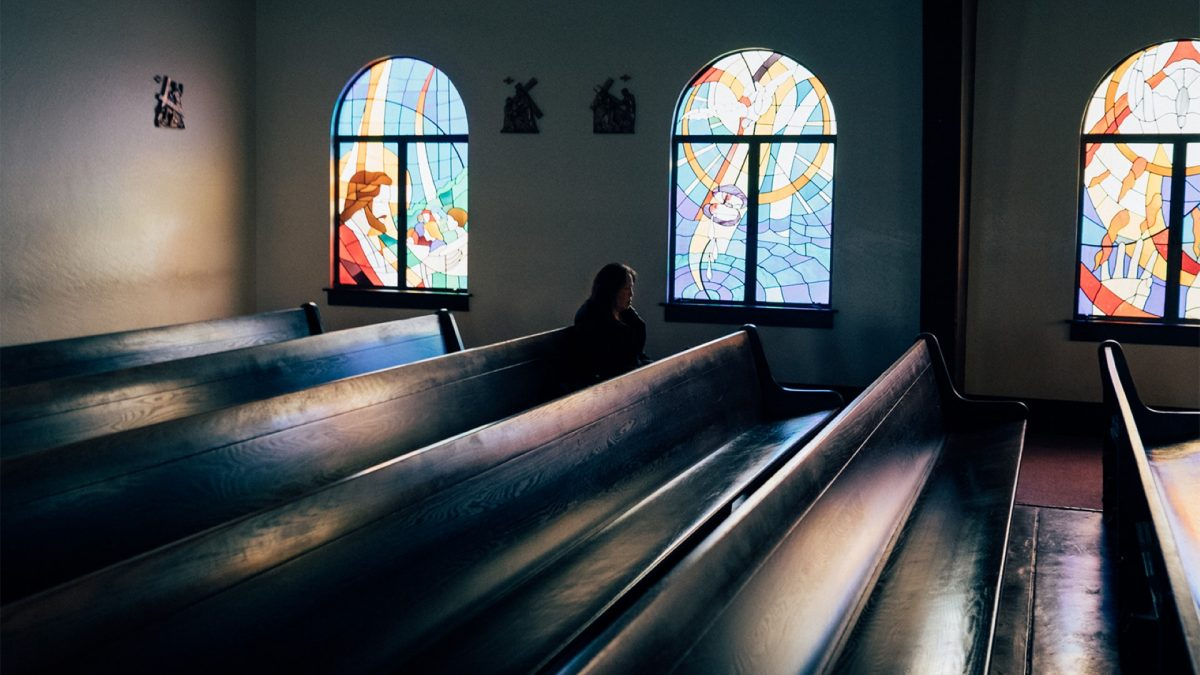 woman in pew