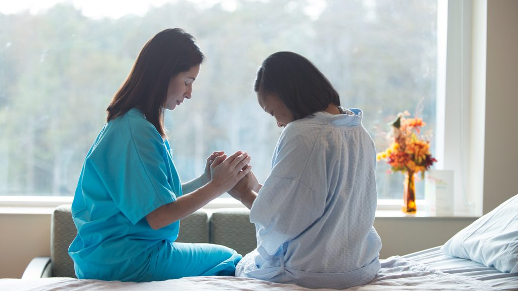 praying with patient