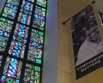 stained glass and compassion banner