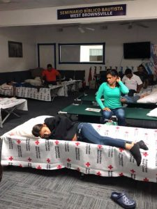 Migrants rest on cots
