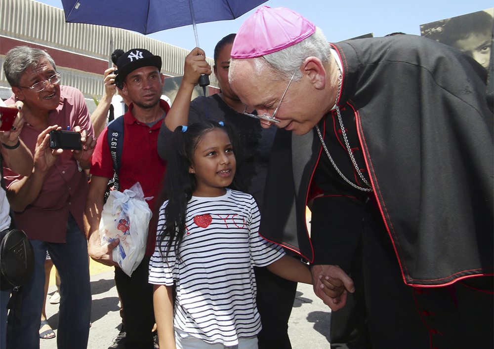 El Paso Catholic Bishop Mark Seitz and child