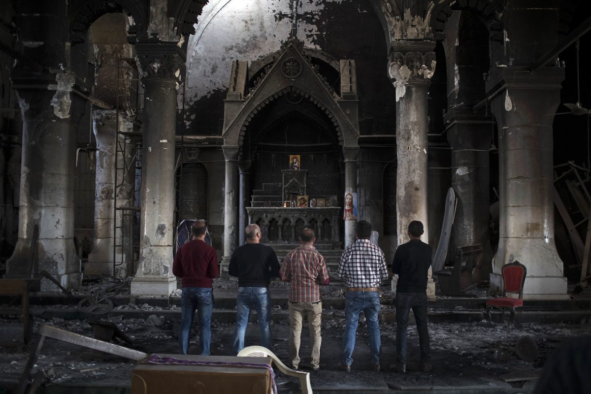 Iraqi Christians pray at church damaged by ISIS fighters