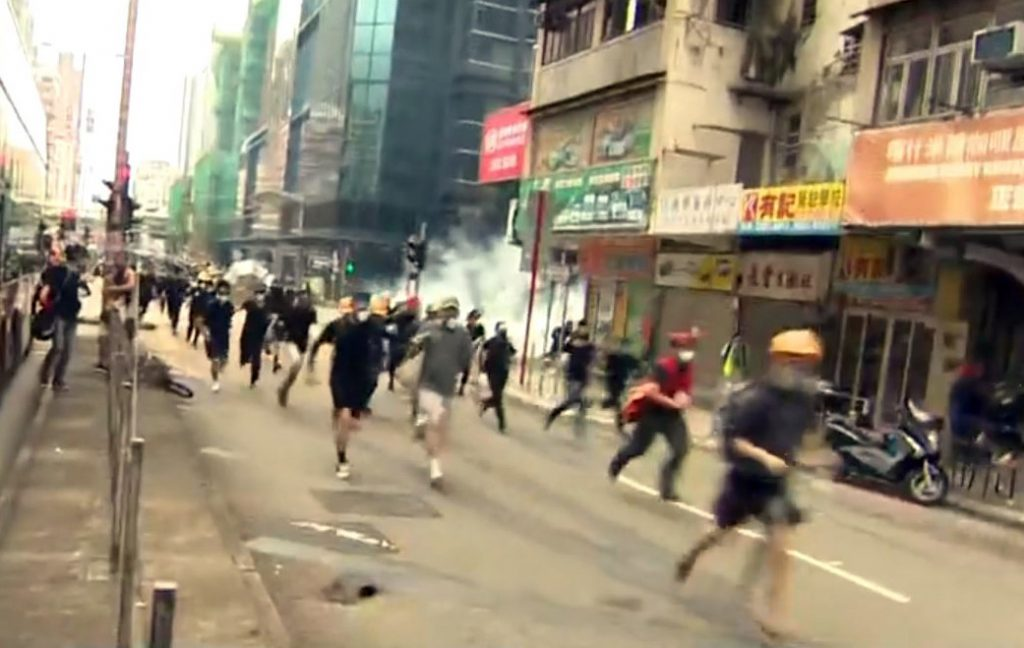 Hong Kong police oppose protesters by force