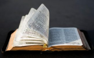 Bible with pages turning