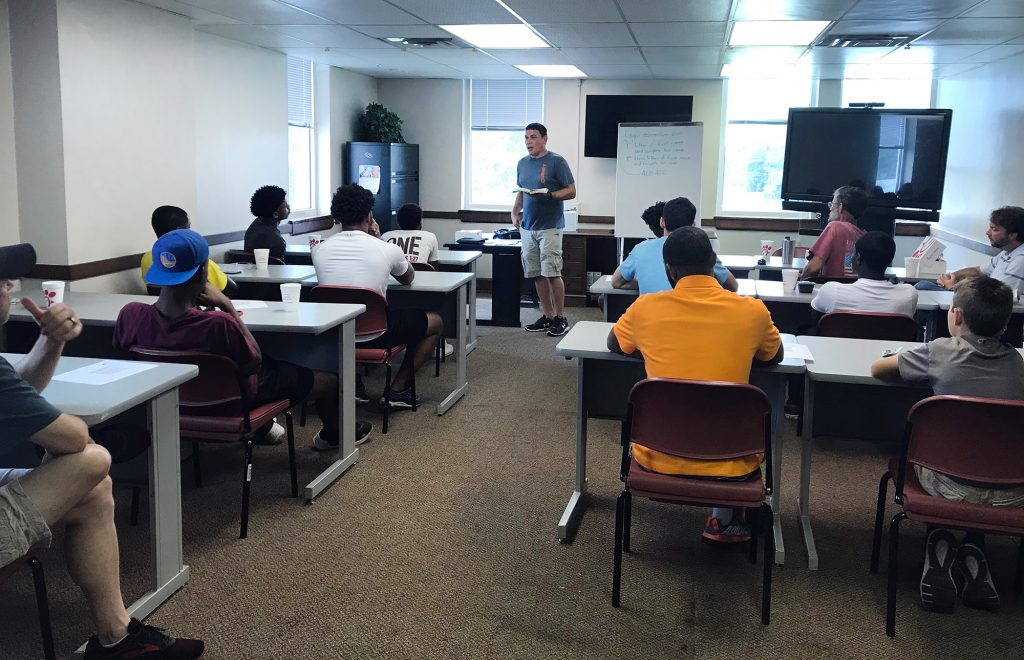 volunteer with The Hope Center teaches a class