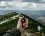 compass and mountains