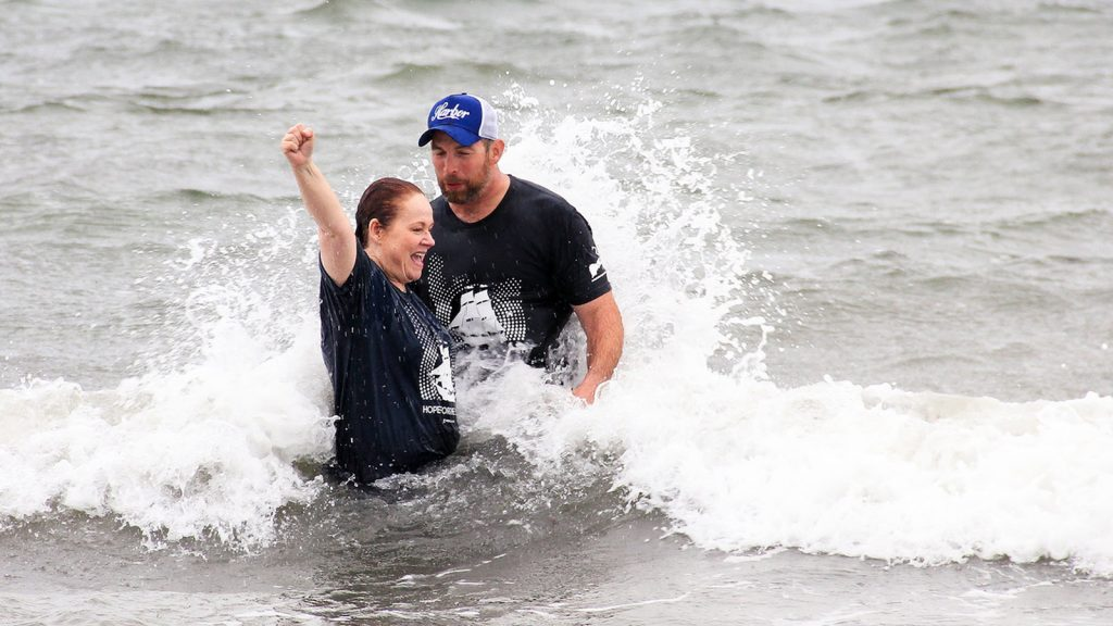 Susie Linnell baptized by pastor Josh Adams