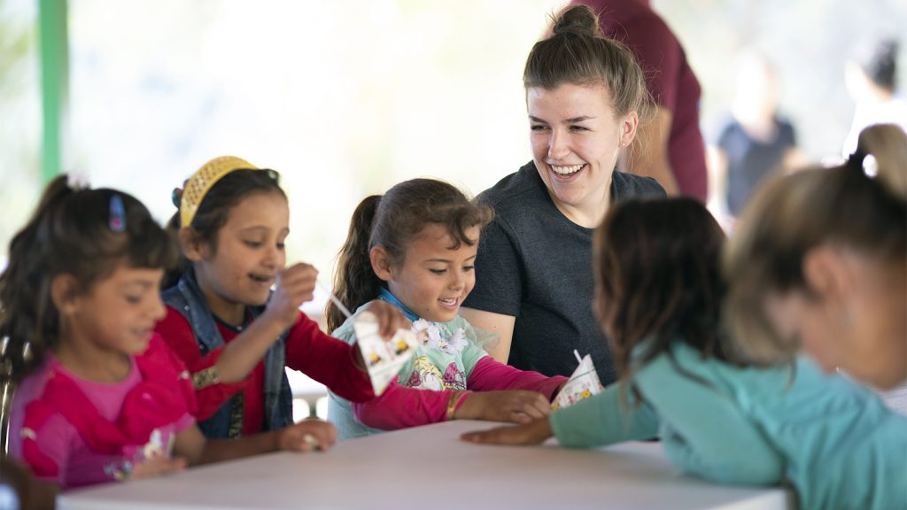 Volunteer Katie Schnizlein with Syrian children