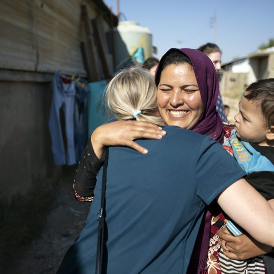 A female Syrian refugee hugs