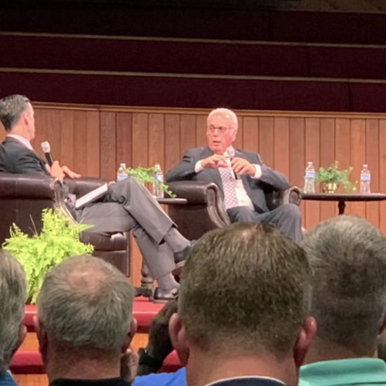 John MacArthur at a panel discussion