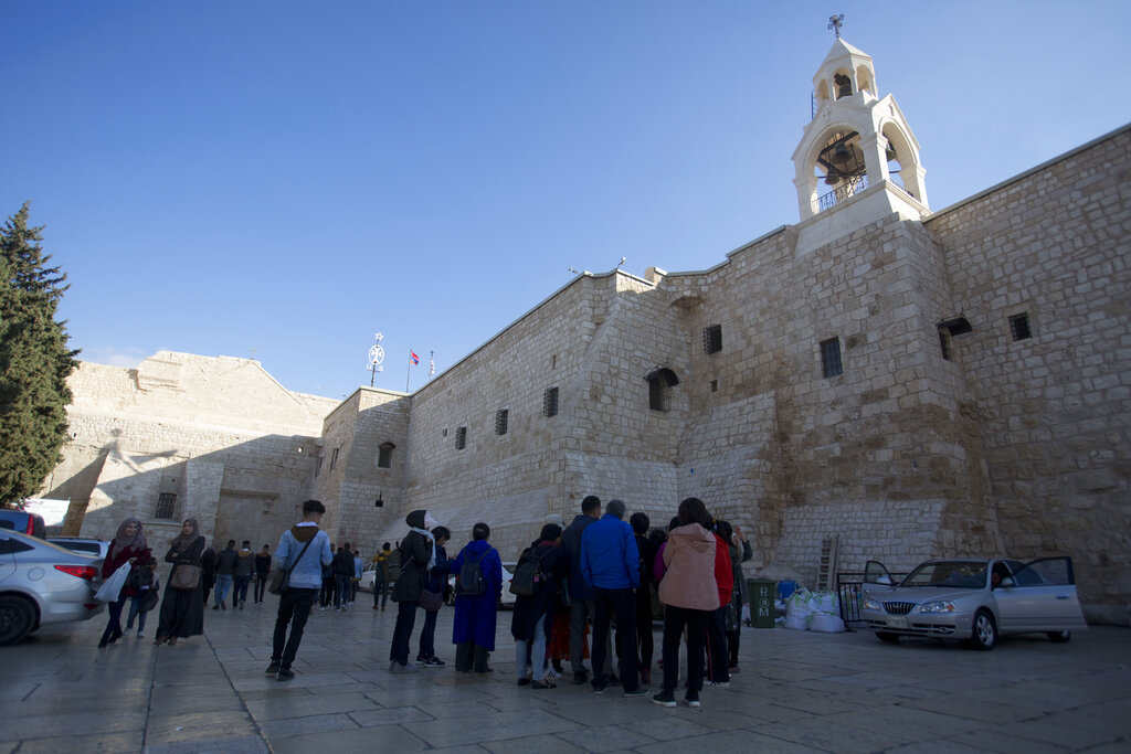 Christian visitors gather outside the Church of the Nativity