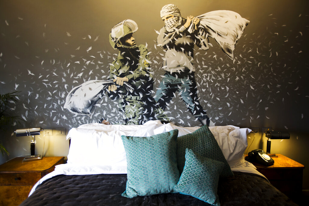 Banksy wall painting showing an Israeli border police officer and a Palestinian in a pillow fight