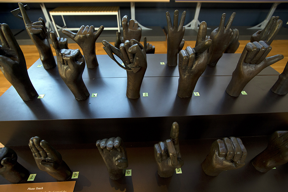 sculpture of hands signing the alphabet