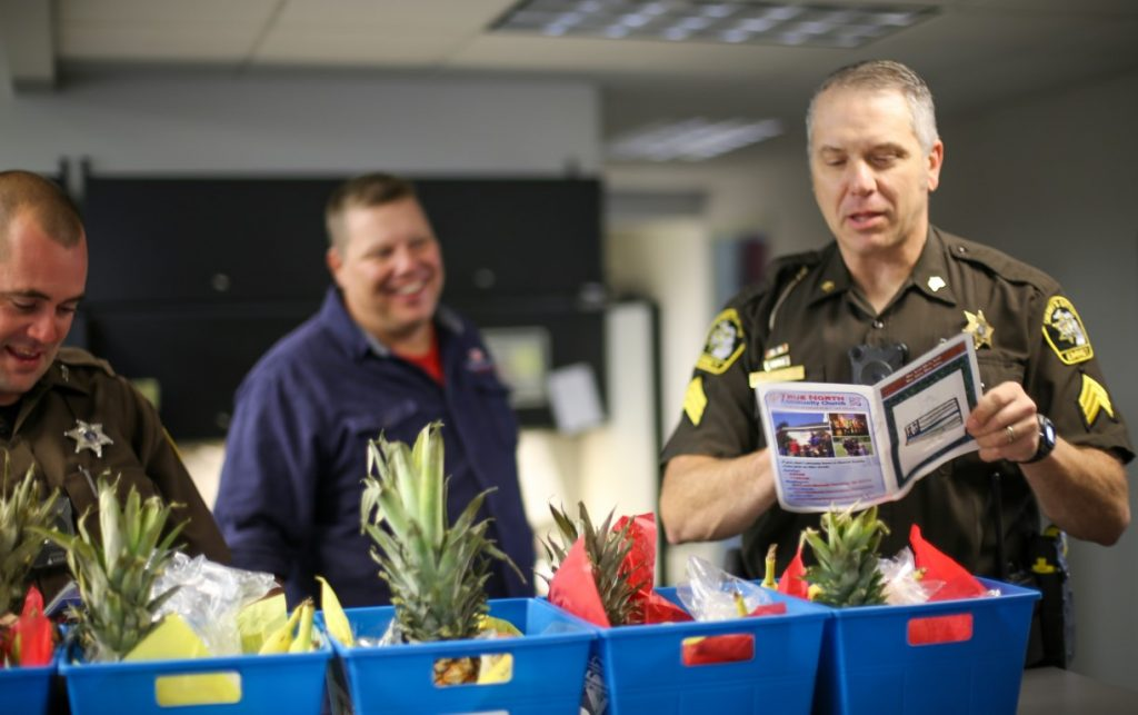 sheriff's department receive fruit baskets