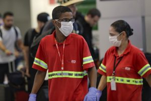 airport workers in masks