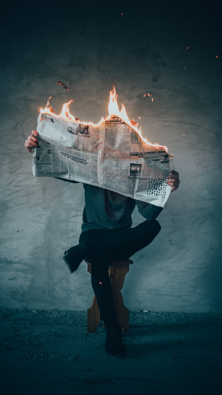 burning newspaper