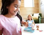 Girl with Barbie doll