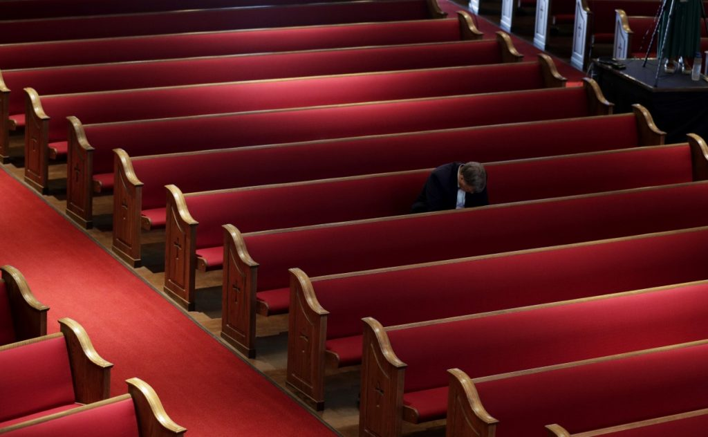 A man prays while attending an Easter