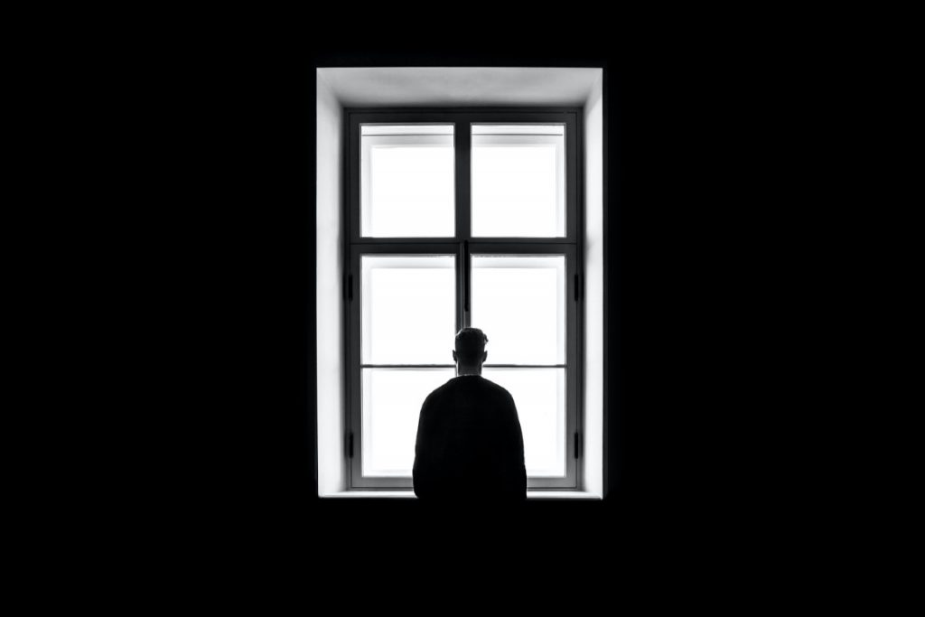 person at window