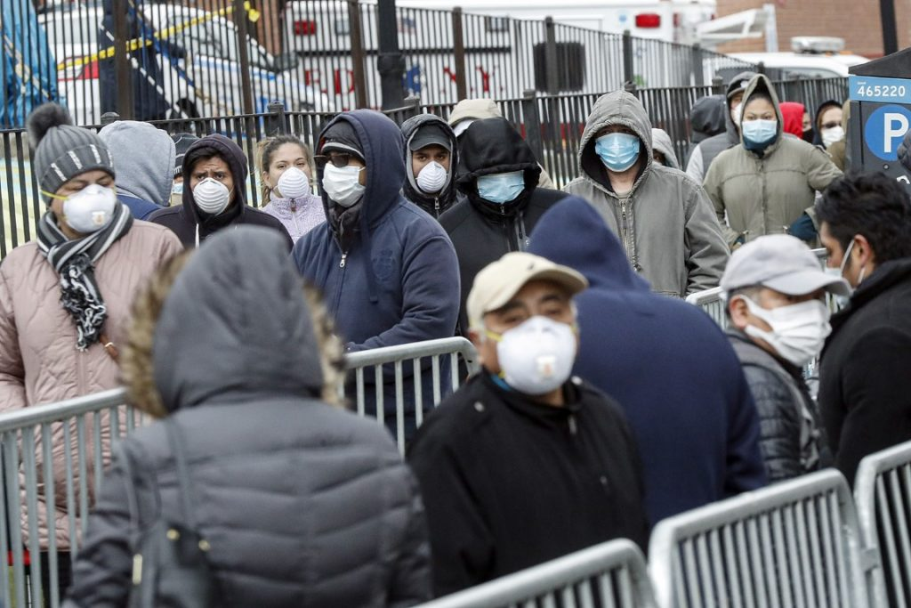 people waiting in line for virus test