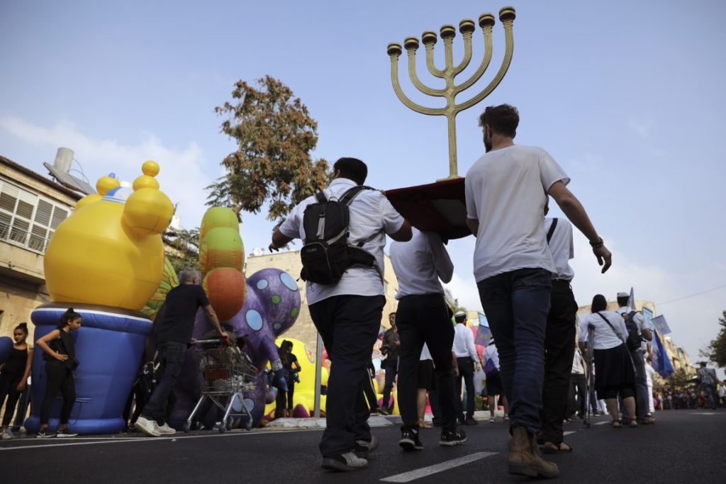 People carry a Menorah