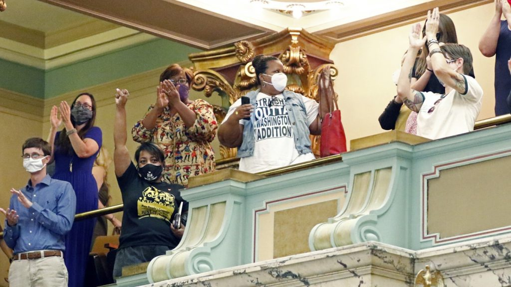 Members of the Mississippi Senate gallery rise and applaud