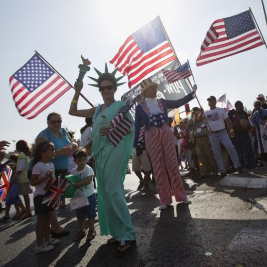 evangelical Christians from various countries wave American flags