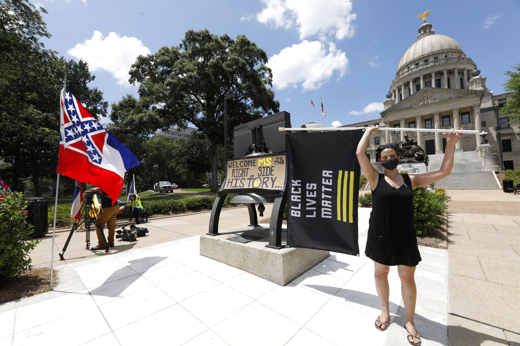 Paloma Wu holds a Black Lives Matter flag